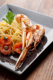 Dish with scampi spaghetti and tomatoes Royalty Free Stock Photo