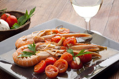 Dish with scampi and tomatoes Stock Photos