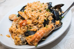 A dish of  seafood rice pics, with mussels, clams, shrimp, musse Stock Photography