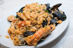 A dish of  seafood rice pics, with mussels, clams, shrimp, musse Stock Photo