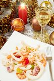 A dish with seafood salad. Seafood salad on christmas table Royalty Free Stock Image