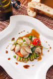 Dish with seafoods and vegetables. Delicatessen dish with seafoods and vegetables Royalty Free Stock Photography