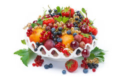 Dish with seasonal fruit and berries, isolated Stock Photos