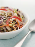 Dish Of Seeded Slaw. On a table with spoon Stock Photos