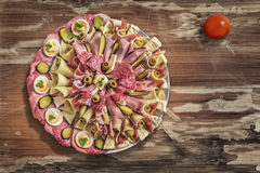 Dish of Serbian Meze with Tomato, placed on very old Wooden Table surface Royalty Free Stock Image