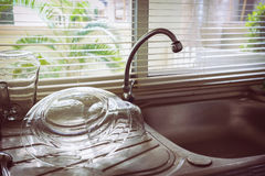 Dish sink in kitchen room Royalty Free Stock Photography
