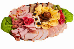Dish with sliced ham, cheese. Dish with sliced ham, cheese and salami rolls, boiled eggs with black caviar and more Stock Photos
