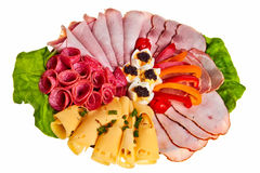 Dish with sliced ham, cheese and salami rolls. Dish with sliced ham, cheese and salami rolls, boiled eggs with black caviar and more Royalty Free Stock Images