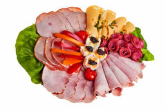 Dish with sliced ham, cheese and salami rolls. Stock Photos