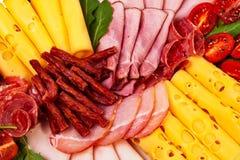 Dish with sliced ham, cheese, salami rolls. Dish with sliced ham, cheese, salami rolls, bacon and lettuce closeup view Stock Image