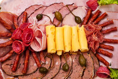 Dish with sliced ham, cheese, salami rolls and let Stock Image