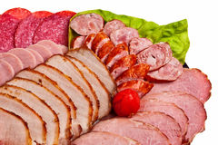 Dish with sliced ham, salami, sausage ... Royalty Free Stock Photos