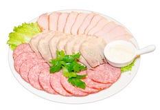 Dish with sliced ham, salami Stock Photos