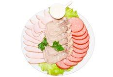 Dish with sliced ham, salami Stock Image