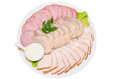 Dish with sliced ham, salami Stock Images