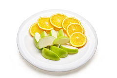 Dish with sliced lemons and apples Stock Image
