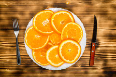 Dish of sliced oranges. food pattern Royalty Free Stock Photo