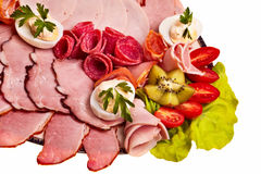 Dish with sliced smoked ham. Royalty Free Stock Images