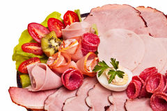 Dish with sliced smoked ham. Stock Photo