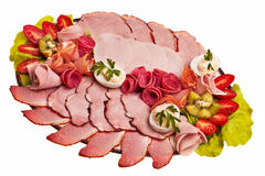 Dish with sliced smoked ham. Stock Image