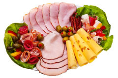 Dish with sliced smoked ham, salami rolls. Stock Image