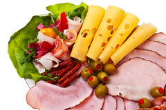 Dish with sliced smoked ham, salami rolls. Royalty Free Stock Images