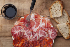 Dish of smoked ham and sausage Royalty Free Stock Images
