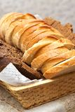 Dish with slices of bread Stock Images
