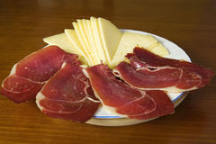 Dish with slices of ham and cheese Royalty Free Stock Photo