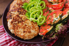 Dish with a snack of fried zucchini with tomatoes. Stock Photo