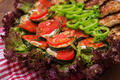 Dish with a snack of fried zucchini with tomatoes Stock Image