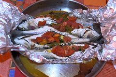 The dish with some grey mullet fishes after bake stock image