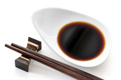 Dish of Soy Sauce with Chopsticks over White Royalty Free Stock Photos