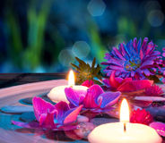 Dish spa with 2 floating candles, orchid on mat. Composition with candles for bath royalty free stock photos