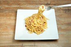 Dish of Spaghetti Carbonara. Shrimp on wood background Stock Photos