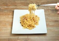 Dish of Spaghetti Carbonara. Shrimp on wood background Royalty Free Stock Image