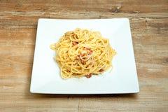Dish of Spaghetti Carbonara. Shrimp on wood background Royalty Free Stock Photography