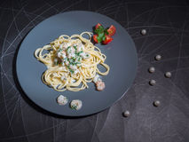 Dish of Spaghetti Carbonara Shrimp on wood background. Creamy pesto seafood Stock Photo