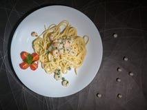 Dish of Spaghetti Carbonara Shrimp on wood background. Creamy pesto seafood, top view Royalty Free Stock Photos