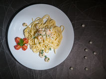 Dish of Spaghetti Carbonara Shrimp on wood background. Creamy pesto seafood, top view Royalty Free Stock Images