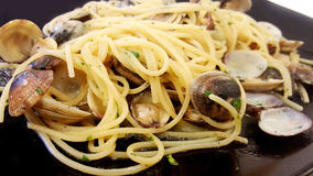 Dish with Spaghetti with clams. Black dish with Spaghetti with clams Royalty Free Stock Photo