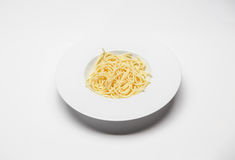 Dish with spaghetti. Shot on white table Royalty Free Stock Photography