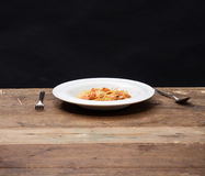 Dish with spaghetti. Shot on wooden table Stock Photography