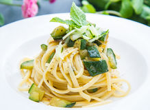 Dish of spaghetti with zucchini and mint leaves. A Dish of spaghetti with zucchini and mint leaves Royalty Free Stock Photo