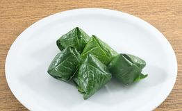 Dish of Spicy Betel Leaf Wrapped Bite Size Appetizer Stock Image