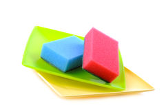 Dish sponge and plates Stock Images