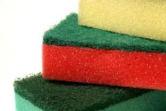 Dish sponges. A pile of red, green and yellow dish sponges, isolated on white stock image