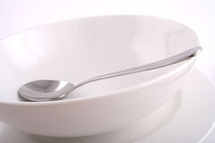 Dish and Spoon Stock Images