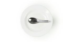 Dish and spoon Royalty Free Stock Photo