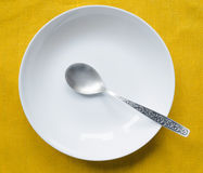Dish with spoon Royalty Free Stock Photo